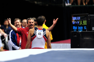 Danell Leyva gets a hug from his coach after his performance
