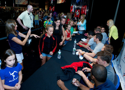 Members of Team Hilton HHonors sign autographs