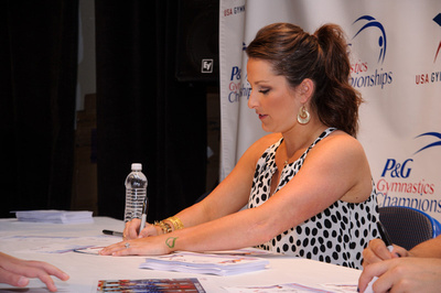 Carly Patterson and Aly Raisman sign autographs