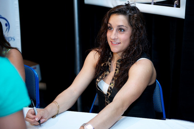 Jordyn Wieber signs autographs before the competition