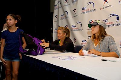 Shawn Johnson and Alicia Sacramone sign autographs