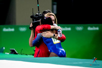 Simone Biles gets a hug from her coach