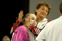 Rebecca Bross gets a hug from Martha Karolyi after her performance