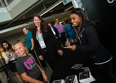 Simone Biles signs autographs before the competition