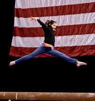 A fan shows her skills on the beam during a rotation break.