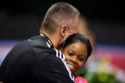 Gabrielle Douglas gets a hug from her coach
