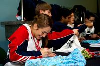 The U.S. trampoline athletes sign autographs