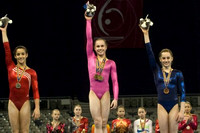 Rebecca Bross (center) and Alexandra Raisman (left) finished first and second on floor exercise