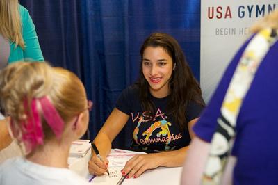 Aly Raisman signs autographs
