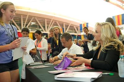 Nastia Liukin and Valeri Liukin sign autographs
