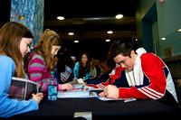 The junior U.S. men sign autographs