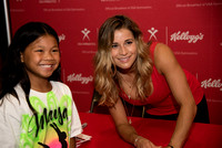 Alicia Sacramone with a fan