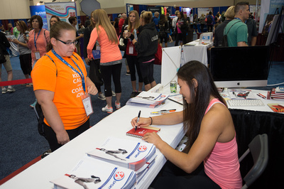 Kyla Ross signs autographs