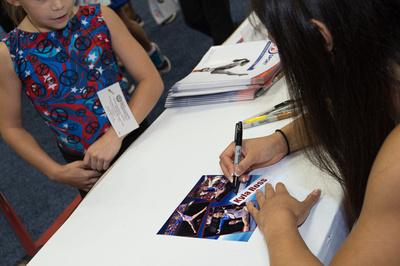 Kyla Ross signs autographs