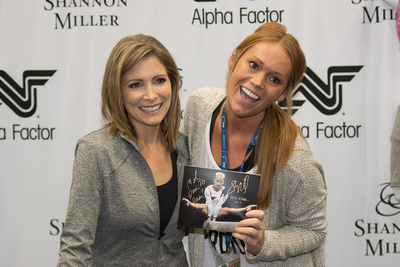 Shannon Miller poses with a fan