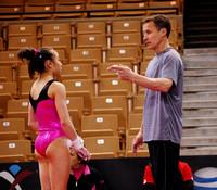 Katelyn Ohashi and her coach, Valeri Liukin
