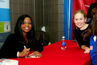 Gabby Douglas signs autographs