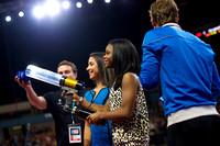 Gabby Douglas and Aly Raisman shoot T-shirts into the crowd