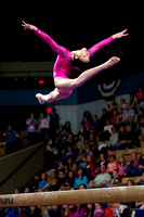 Kyla Ross performs an exhibition on beam