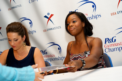 Gabby Douglas and Carly Patterson sign autographs