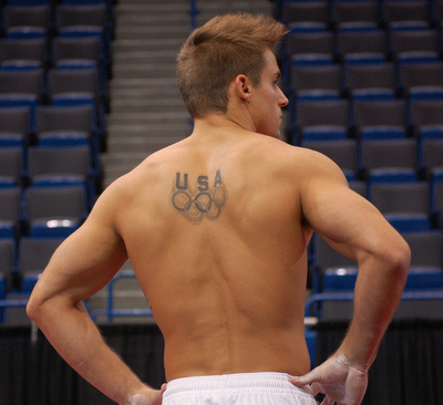 Sam Mikulak with his Olympic rings tattoo