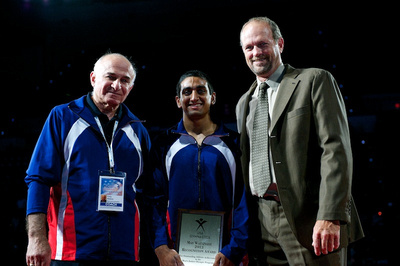 Akash Modi (center) and his coach received special awards