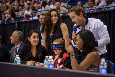 John Macready with Jordyn Wieber, Aly Raisman and Gabby Douglas with a fan