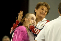 Rebecca Bross gets a hug from Martha Karolyi after her performance