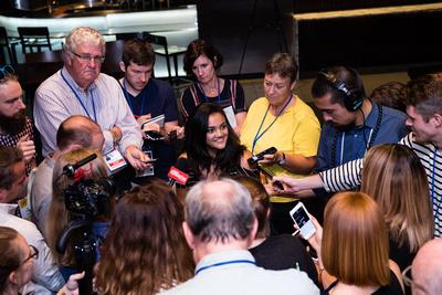 Laurie Hernandez talks to the media