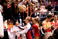 The women sign autographs after the competition