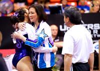 Anna Li gets a hug from her coach