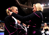Nastia Liukin presents each girl with a ribbon