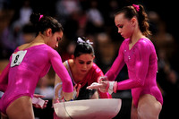Alexandra Raisman and Rebecca Bross prepare for the bars