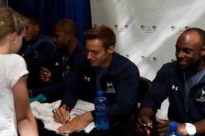 Sam Mikulak signs an autograph
