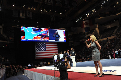 Alyssa Beckerman, an alternate for the 2000 bronze medal Olympic Team, sang the National Anthem