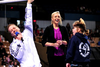 Nastia Liukin and John Macready interact with a fan