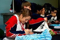 The U.S. trampoline athletes sign autographs