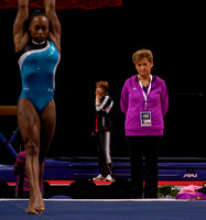 Martha Karolyi looks on as Elizabeth Price warms up.