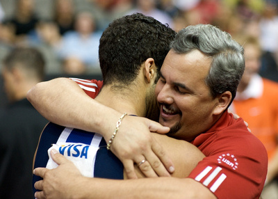 Danell Leyva gets a hug from his father/coach Yin Alvarez