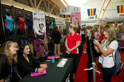 Aly Raisman signs autographs and poses for pictures