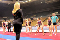The girls line up as Nastia looks on.