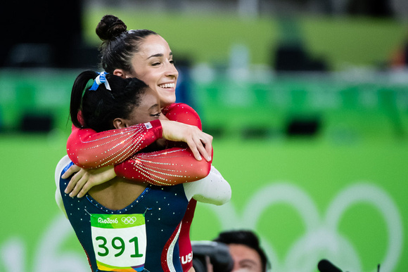 Simone Biles and Aly Raisman hug after finding out they won gold and silver